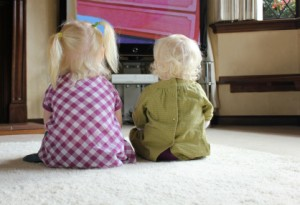 children watching television together